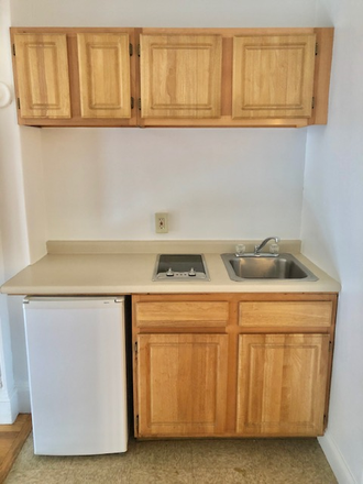 KITCHENETTE - SUN SPLASHED & RENOVATED STUDIO WITH HARDWOOD FLOORS AT 1061 BEACON STREET AVAILABLE 9/1/2021 Apartments