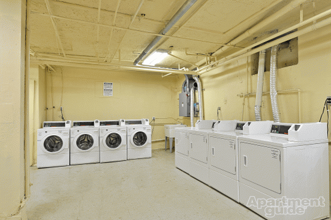 laundry room - Camelot Apartments