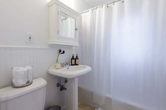 Bright bathroom with weekly fresh towels