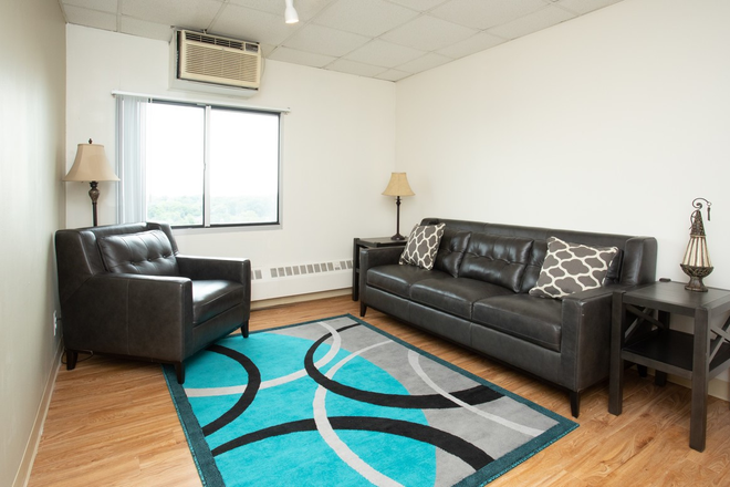 Living Room 2 Bed Apartment - University Towers - Perfectly located on Central Campus Apartments