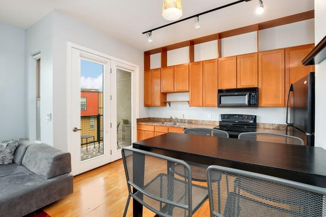 Kitchen to furnished balcony - *Furnished* 720 sqft 1bdrm/1ba apartment w/ secure parking, storage