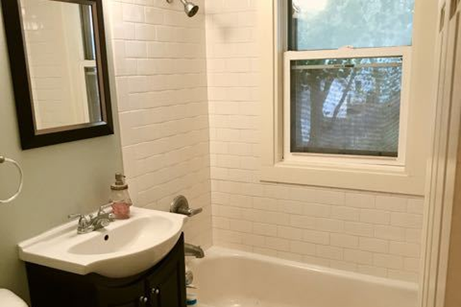 Upper Bathroom - Fully renovated 4BD 2BA house in historic part of Saint Paul Rental