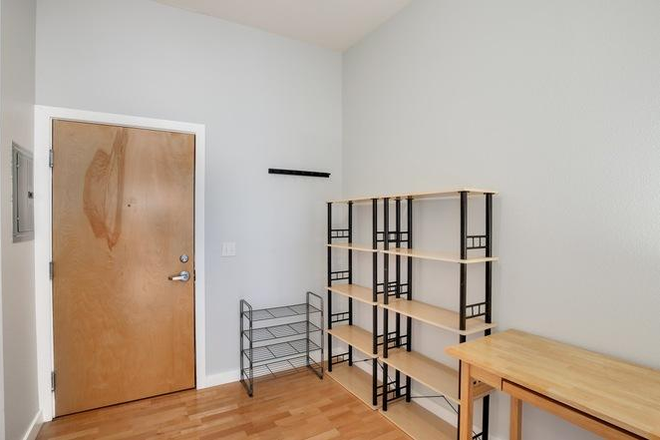 Entry way with shelving, storage - *Furnished* 720 sqft 1bdrm/1ba apartment w/ secure parking, storage