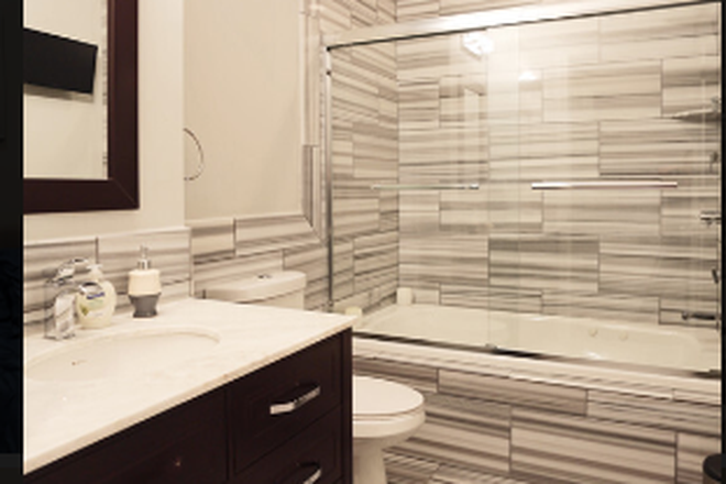 Bathroom with Jacuzzi bath tub - $1510  for Luxury 1bd apartment full of amenities