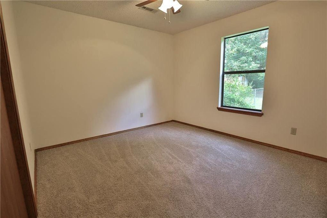 Typical Bedroom - Beautiful single family home in great location near UofA and I49. Rental