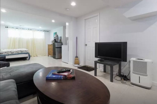 Basement Living Area - Basement Suite in Solar Powered DC Townhouse w/ All Utilities/Cleaning Included