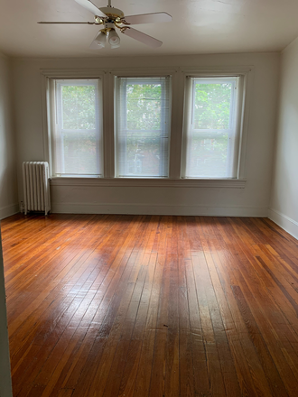 Top Floor Front Bedroom - Student Housing Available in Historic Charles Village Townhome