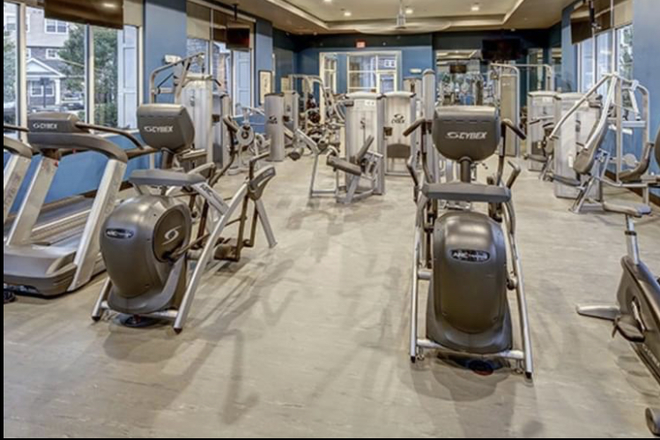 24/7 Gym Area - Premium Townhome Apartment Available! Move in as soon as you're available.