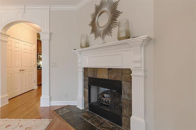 living room and fireplace - Comfy-upscale townhome at the right price!