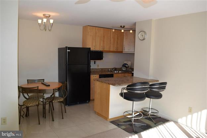 Kitchen with Breakfast Bar - Furnished One Bedroom Condo