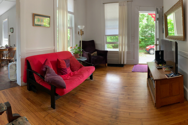 Living Room with futon and TV - Downtown Amherst -- Furnished, 3Room, 1Bed/1Bath, all inclusive Rental