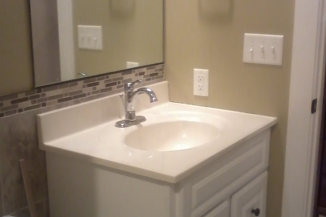 Bathroom - S & H Properties II 1/2 off first months rent Apartments