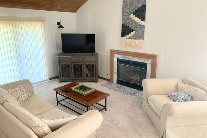 Living Room, 50in Smart TV & fireplace - Crooked Creek Townhome