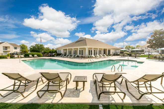 Pool area - Laurel Park - Conveniently located in Flowood with a $25 monthly discount! Apartments